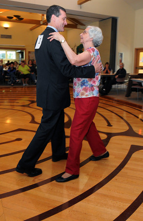 KEN YUSZKUS/Staff photo. Beverly Mayor Mike Cahill dances with Elaine Caron during the Dancing with the Stars competition held at the Beverly Senior Center.      5/20/14