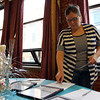 Stephanie Oxenford, a parent of a Nathaniel Bowditch student, writes down her bid for the silent auction at the second annual Bowditch Bash fundraiser held at the Moose Lodge in Salem on Friday evening. DAVID LE/Staff photo. 5/2/14