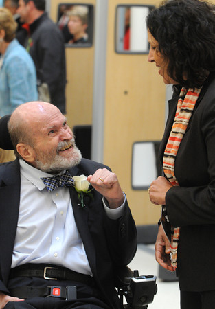 KEN YUSZKUS/Staff photo.  Senator Fred Berry is greeted by Salem Mayor Kim Driscoll at the start of the Frederick E. Berry Library and Learning Commons Dedication Ceremony at Salem State University.  5/28/14.