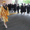 KEN YUSZKUS/Staff Photo. Senior class president Arianna Maida leads the procession of graduates past the applauding faculty at the start of the Bishop Fenwick graduation.  5/23/14.