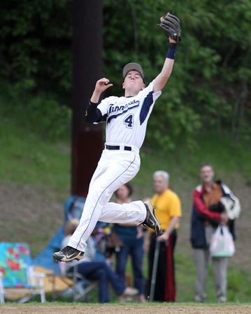 Peabody third baseman Bobby Tramondozzi (4) makes a leaping catch to retire an Everett batter on Monday evening. DAVID LE/Staff photo. 5/26/14.