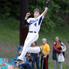 Peabody third baseman Bobby Tramondozzi (4) makes a leaping catch to retire an Everett batter on Monday evening. DAVID LE/Staff photo. 5/26/14.