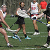 KEN YUSZKUS/Staff photo.  Masco's Caroline Chipman sends the ball past Ipswich's goalie Eliza Statile into the net at the Ipswich at Masconomet girls lacrosse game. 5/12/14