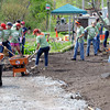 KEN YUSZKUS/Staff photo.  Volunteers from Timberland in Stratham NH are working on Putnamville Park in Danvers.        5/15/14