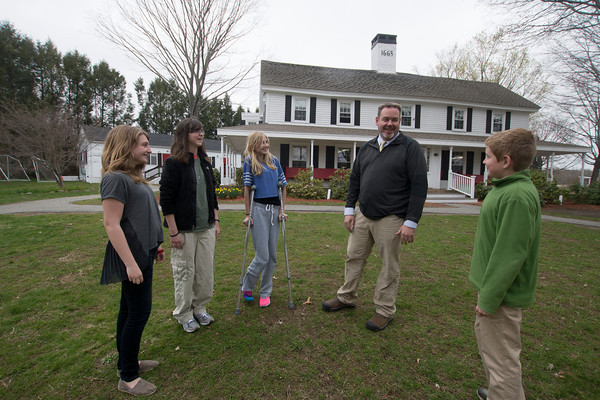 JIM VAIKNORAS/Staff photo Jeff Clark talks with students Paige Walker of Reading, Maddy Kelema of Beverly, Jacey Rocco of Peabody and Aidan Marreotti of Lynnfeild,  infront of the Clark School in Danvers. The school is moving to Rowley.