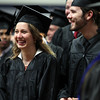 Gordon College graduates Jane Dietrich and Nick Carmer smile as their professors walk past during the processional at the start of Commencement on Saturday morning. DAVID LE/Staff photo. 5/18/14.