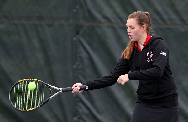 Salem junior Katherine Towey returns a serve against Swampscott during second doubles play on Tuesday afternoon. DAVID LE/Staff photo. 5/13/14.
