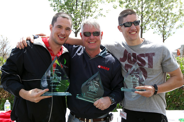 From left, first, second, and third place finishers from the Hot Wing Challenge, Martin Christensen, Dan Sutherland, and Patrick Wallace, pose with their awards during a final worker barbecue on Thursday afternoon. David Le/Staff Photo. 5/16/14.