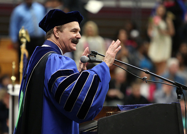 Dennis Hollinger, President and Professor of Christian Ethics at Gordon-Conwell, delivers his opening remarks during Commencement on Saturday morning. DAVID LE/Staff photo. 5/10/14