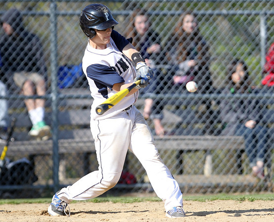 Pingree freshman Cameron Schmitt lines a single to left against Lexington Christian Academy on Wednesday afternoon. DAVID LE/Staff photo. 5/14/14.