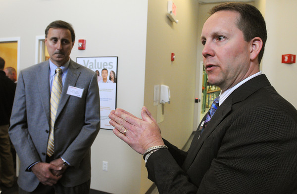 KEN YUSZKUS/Staff photo.  ThermoFisher Scientific president Jeff Jochims, right, speaks about Thermo Fisher Scientific opening a new Doe & Ingalls Northeast Chemical Distribution Facility in Peabody. Director of operations of Doe & Ingalls Andy Finn, left, listens. 5/8/14