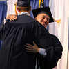 St. John's Prep graduate Matthew Censullo, right, gives Valedictorian Alec McNiff a hug after his Valedictory Address during Commencement on Sunday afternoon at Ryken Field in Danvers. DAVID LE/Staff photo. 5/18/14.