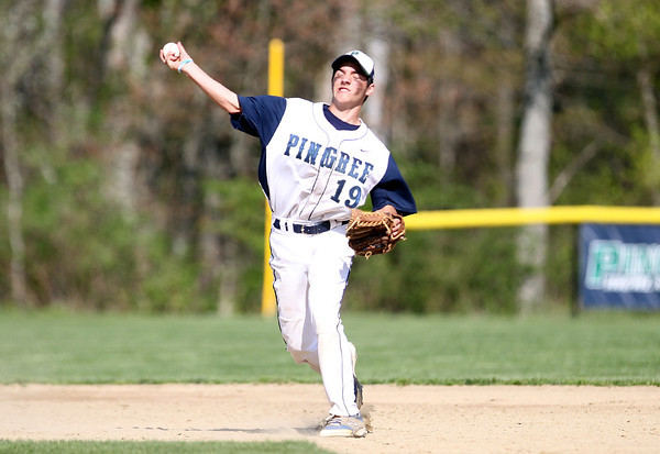 Pingree freshman shortstop Zachery Mitchell fires to first to throw out a Lexington Christian Academy runner. DAVID LE/Staff photo. 5/14/14.