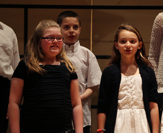 """From left, Elizabeth Lima, Ethan Dwyer, and Angelina Puglisi, of the All City Elementary Chorus sing along to """"The Ash Grove"""" during the All-City Choral Concert on Wednesday evening at Salem High School. DAVID LE/Staff photo. 5/21/14."""