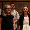 "From left, Elizabeth Lima, Ethan Dwyer, and Angelina Puglisi, of the All City Elementary Chorus sing along to ""The Ash Grove"" during the All-City Choral Concert on Wednesday evening at Salem High School. DAVID LE/Staff photo. 5/21/14."