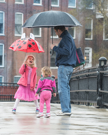 DESI SMITH/STAFF Photo  Maddie Julien 5, of Haverhill, has some fun in the rain with her sister Charlotte 2, and her dad Greg, as they cross over a bridge thats part of the Ipswich River Walk Saturday afternoon in Ipswich. Greg who works in Ipswich, took his daughters for lunch in town and then for a short walk in the rain.<br />    April 26,2014