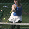 KEN YUSZKUS/Staff photo. Danvers singles player Jenn Lueke competes during the Peabody at Danvers girls tennis match.       5/5/14