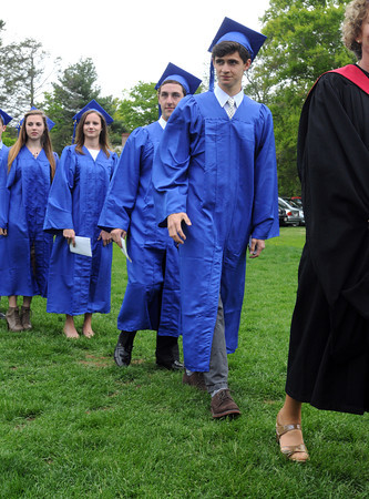 KEN YUSZKUS/Staff Photo. Henry Balf, right, leads the grads into the tent during the processional at the graduation ceremony at the Waring School in Beverly.     5/23/14.