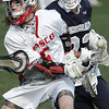 KEN YUSZKUS/Staff photo. Masco's Max Craig loses the ball as Hamilton-Wenham's Lattanzi barrels down during the Hamilton-Wenham at Masconomet boys lacrosse game.   5/6/14