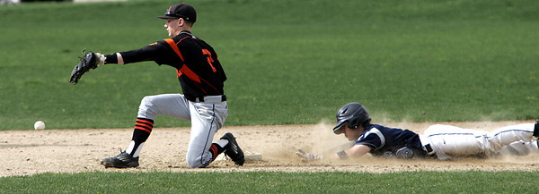 KEN YUSZKUS/Staff photo. Peabody's Ryan Collins steals 2nd with Beverly's Sean Curtin missing the throw during the Peabody at Beverly baseball game for the Northeastern Conference North title.      5/19/14