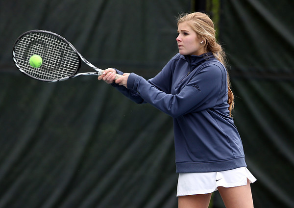 Swampscott junior Anya Peterson returns a volley against Salem in first doubles play on Tuesday afternoon. DAVID LE/Staff photo. 5/13/14.