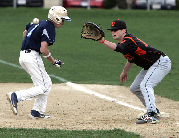 KEN YUSZKUS/Staff photo. Peabody's Matt Correale gets back on 1st as Beverly's Kevin Cuneo gets the ball from pitcher Dave drinkwater during the Peabody at Beverly baseball game for the Northeastern Conference North title.      5/19/14