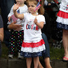 Three-year-old Paige Dembowski waves at the Danvers High School marching band as they parade bye on Monday morning. DAVID LE/Staff photo. 5/26/14.