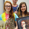 KEN YUSZKUS/Staff photo.  Peabody Veterans Memorial High Schoolers from left, are Sarah Perrin holding her french horn, Bernie Baldassaro, Michelle Poirer who is hoding a photo of her acrylic painting.        5/12/14