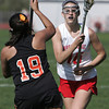KEN YUSZKUS/Staff photo.  Ipswich's JoAnna Perry swats at the ball that Masco's Grace Fahey has during the Ipswich at Masconomet girls lacrosse game. 5/12/14