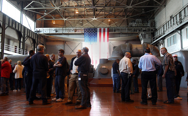 Following a cookout, a few speeches, and a large group photo, current and former employees of the Salem Power Plant conversed in between a few of the turbines. David Le/Staff Photo. 5/16/14.