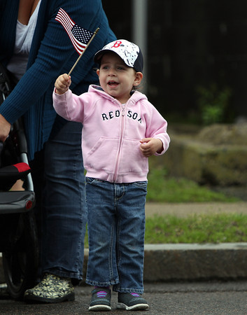 Two-year-old Olivia Resendes, waves an American flag as the annual Danvers Memorial Day Parade passes bye on Monday morning. DAVID LE/Staff photo. 5/26/14.