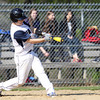 Pingree freshman Cameron Schmitt (18) lines a two-RBI triple to left in the first inning of play. DAVID LE/Staff photo. 5/14/14.