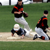 KEN YUSZKUS/Staff photo. Peabody's Matt Correale gets hurt sliding safely into 2nd on a steal during the Peabody at Beverly baseball game for the Northeastern Conference North title. Beverly's John Berchoff is in the background and Sean Curtin is on the right.      5/19/14