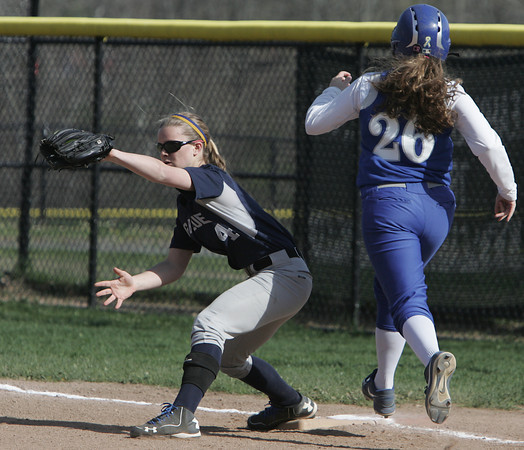 KEN YUSZKUS/Staff photo.  Swampscott's Hannah Leahy gets the throw as Danvers' Devyn Dauns is out at 1st during the Danvers at Swampscott softball game.      5/7/14