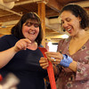 Yvonne Jones, left, and Natalie Pavia, of Salem, pick out silent auction items to bid on at the second annual Bowditch Bash fundraiser held at the Moose Lodge in Salem on Friday evening. DAVID LE/Staff photo. 5/2/14