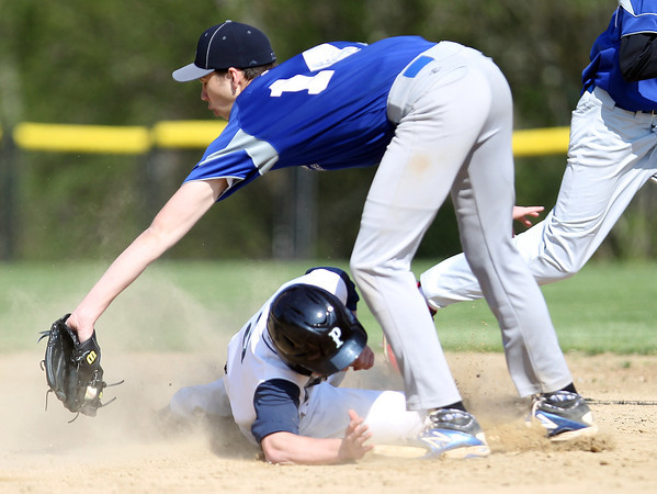 Pingree senior Reese Fulmer (3) slides safely into second base before Lexington Christian Academy second baseman Ryan Ahern (14) can apply the tag. DAVID LE/Staff photo. 5/14/14.