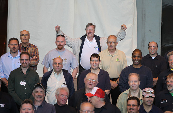 Past and present employees of the Salem Power Plant pose for a group shot during a final worker barbecue on Thursday afternoon. David Le/Staff Photo. 5/16/14.