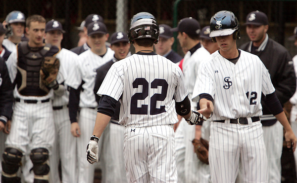 KEN YUSZKUS/Staff photo. St. John's Prep Keith Leavitt of Gloucester walks back to his teammates after hitting a homerun during the Lowell at St. John's Prep in the first round of the Super 8 baseball state playoffs. 5/28/14.