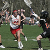 KEN YUSZKUS/Staff photo.  Masco's Kathleen Gillespie, left, gets ready to send the ball past Ipswich's goalie Eliza Statile at the Ipswich at Masconomet girls lacrosse game. 5/12/14