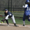 KEN YUSZKUS/Staff photo.  Swampscott's Christina King misses the throw to first as Danvers' Meghan Llewellyn gets on safe during the Danvers at Swampscott softball game.      5/7/14
