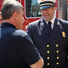 Father Chris Foustoukos, of St. Vasilios Greek Orthodox Church is being appointed as the Peabody Fire Department's full-time volunteer chaplain. He shakes hands with Captain Ted Quinn on Wednesday afternoon. DAVID LE/Staff photo. 5/14/14.