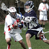 KEN YUSZKUS/Staff photo. Masco's Jake Jesi, left, pressures Hamilton-Wenham's C. Johnson during the Hamilton-Wenham at Masconomet boys lacrosse game.   5/6/14
