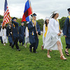 KEN YUSZKUS/Staff photo. Class of 2014 co-presidents Kathryn Gallo and Matthew Mogavero lead the grads in the processional to start the Peabody Veterans Memorial High School graduation.   5/30/14.