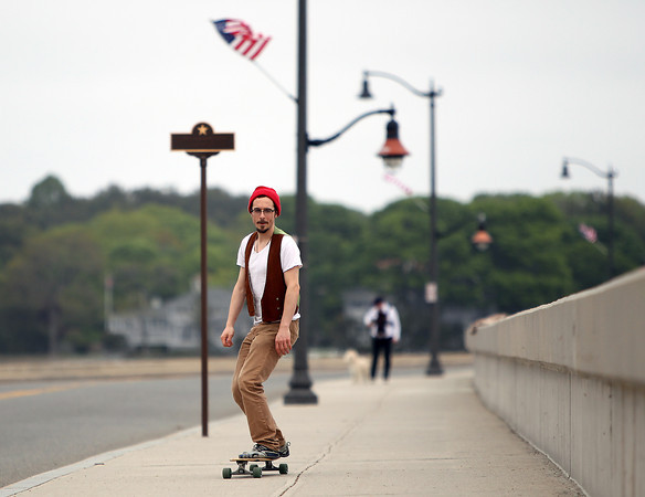 Salem resident Dan Wicker longboards down the Causeway in Marblehead on Tuesday afternoon. DAVID LE/Staff photo. 5/27/14.