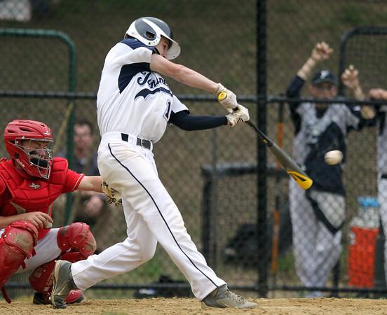 Peabody center fielder Matt Gonick (17) lines a single against Everett on Monday evening. DAVID LE/Staff photo. 5/26/14.