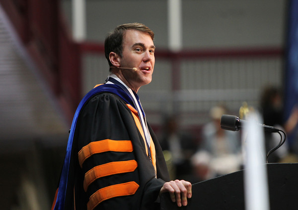 Gordon College President Dr. Michael Lindsay gives his opening remarks on Saturday morning during Commencement. DAVID LE/Staff photo. 5/18/14.