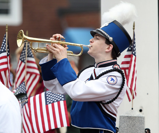 Danvers High School junior Patrick Berry plays taps at Danvers Square after the placing of a memorial wreath on Monday morning. DAVID LE/Staff photo. 5/26/14.
