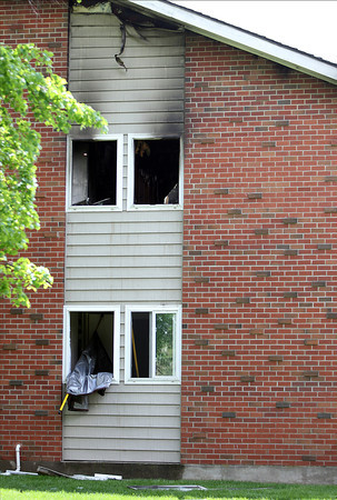 A fire tore through a Terrace Estates apartment complex in Peabody on Sunday afternoon. DAVID LE/Staff photo. 5/18/14.