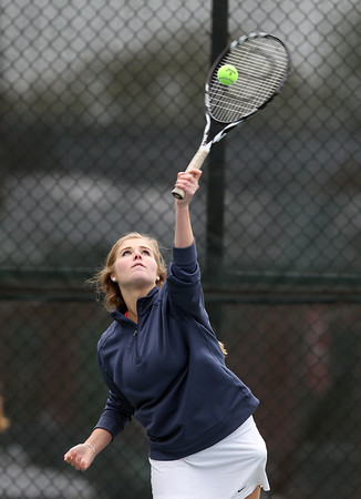 Swampscott junior Anya Peterson smashes a serve against Salem on Tuesday afternoon. DAVID LE/Staff photo. 5/13/14.