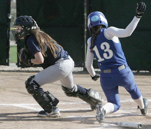 KEN YUSZKUS/Staff photo.  Swampscott's catcher Olivia Cooke gets the ball to get Danvers' Marissa Manson out at home plate during the Danvers at Swampscott softball game.      5/7/14